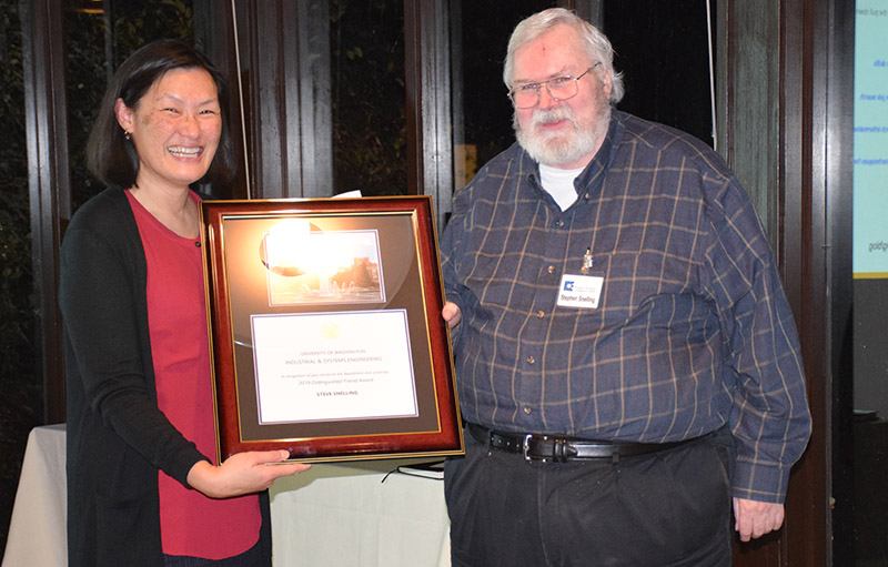 Linda Boyle handing a plaque to Steve Snelling